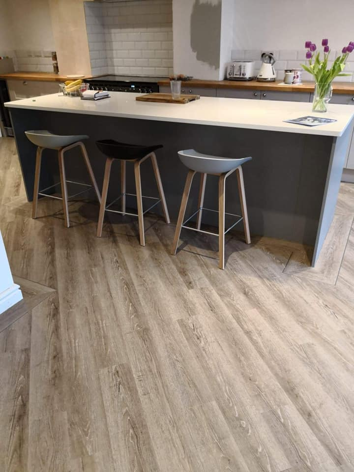Bespoke design Harbour Oak laid on the diagonal in a kitchen, complete with infill design around counter